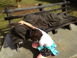 Homeless Jesus freaking out a little girl...